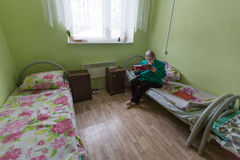Elderly woman in rehabilitation department in Center of social services for pensioners and the disabled Royalty Free Stock Images