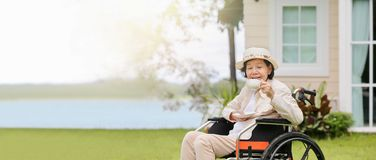 Elderly woman relax in backyard royalty free stock photos