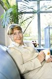 Elderly woman relaxing Stock Images