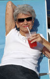 Elderly woman relaxing Stock Image