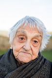 Elderly woman with resignation expression Royalty Free Stock Images