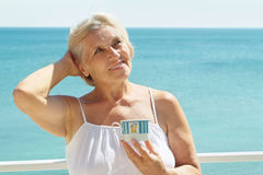 Elderly woman  at the resort Royalty Free Stock Photo