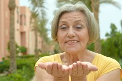 Elderly woman at resort Royalty Free Stock Photos