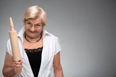 Elderly woman with rolling pin Royalty Free Stock Image