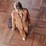 Elderly woman with rolling suitcase royalty free stock photos