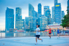 Elderly woman running in Singapore Royalty Free Stock Images