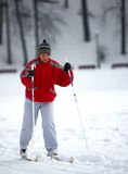 Elderly woman running ski Royalty Free Stock Image