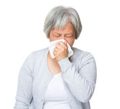Elderly woman runny nose Stock Photo