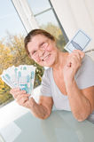 Elderly woman with Russian money and savings book. Studio photography at the table on a light background Stock Images