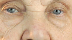 Elderly woman`s face with tired expression of face stock video footage