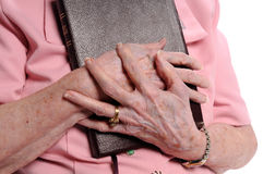 Elderly Woman's Hand Holding Bible Stock Photography