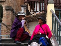 Elderly woman's sitting on the stairs. A conversation on the stairs between two elderly woman's in Cuenca Ecuador Stock Photos