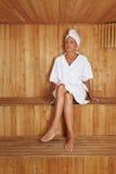 Elderly woman in sauna stock images