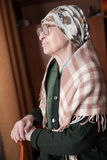 Elderly woman in scarf and glasses stock photo