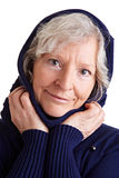 Elderly woman with scarf and hood Royalty Free Stock Images