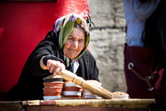 Elderly Woman Selling Birdseed Stock Photos