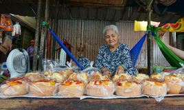 Elderly woman selling rice cakes Royalty Free Stock Photos