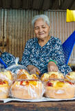 Elderly woman selling rice cakes Royalty Free Stock Photo