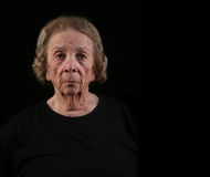 Elderly Woman With Serious Look on Her Face Stock Image