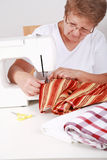Elderly woman sewing Stock Image