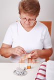 Elderly woman sewing Royalty Free Stock Image