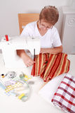 Elderly woman sewing Stock Photo
