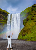 Elderly woman shocked by the waterfall Royalty Free Stock Photo