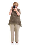 Elderly woman shooting Stock Photography
