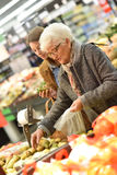 Elderly woman shopping with her daughter groceries stock photo