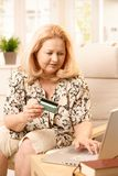 Elderly woman shopping on internet Stock Image
