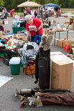 Elderly Woman Shopts At City Gargage Sale Royalty Free Stock Photos