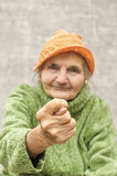 Elderly woman showing fig sign. Selective focus on hand royalty free stock images
