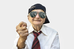 Elderly woman showing fig sign. Stock Photos