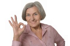 Elderly woman showing sign of ok Royalty Free Stock Images