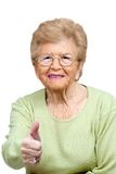Elderly woman showing thumbs up. Royalty Free Stock Photo