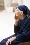 Elderly woman sideview stock photo