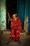 An elderly woman sits on her doorstep in the Dharavi Slums in Mu Royalty Free Stock Photos