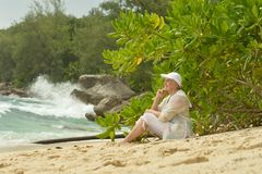 Elderly woman  sitting on a bench outdoors Royalty Free Stock Photos