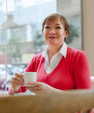 Elderly woman sitting in   cafe Stock Photo