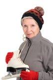 Elderly woman with skates Stock Photo
