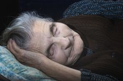 An elderly woman is sleeping Royalty Free Stock Image