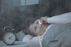 Elderly woman with sleeping disorders Stock Photos