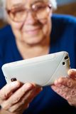 Elderly woman with a smartphone Stock Photos