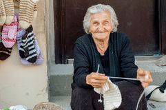 Elderly woman with smiley face knitting needles wool socks Stock Photos