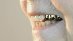 Elderly woman smiling with false teeth. Close up stock video footage
