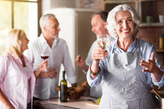 Elderly woman smiling in the kitchen Royalty Free Stock Photo