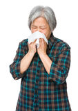 Elderly woman sneeze Stock Photos