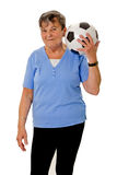 Elderly woman with soccer ball Royalty Free Stock Image