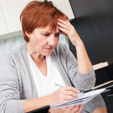 Elderly woman sorting through her old receipts Royalty Free Stock Images