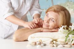 Elderly woman in the spa salon Royalty Free Stock Image